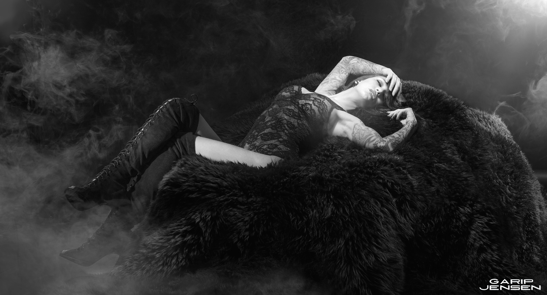 Swedish tattooed model wearing a black lace body