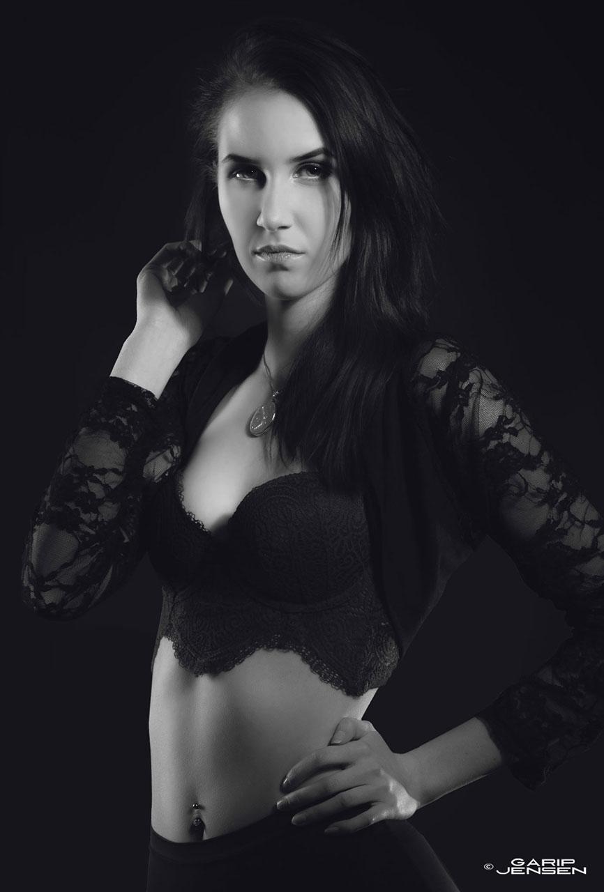 Portrait of a female model, wearing a black top