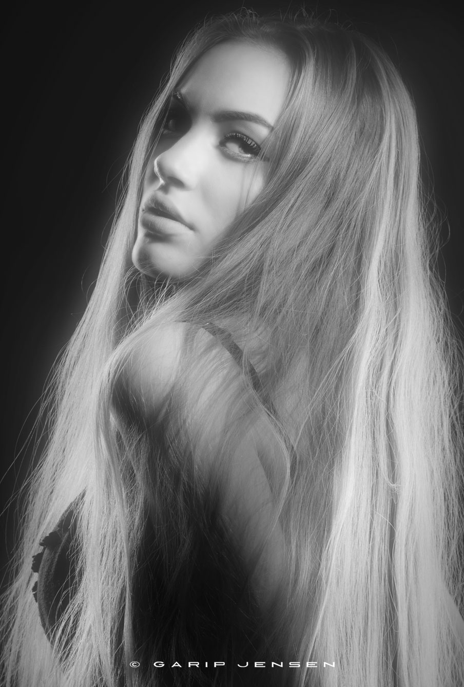 portrait of a young blond Swedish model, with long blond hair.