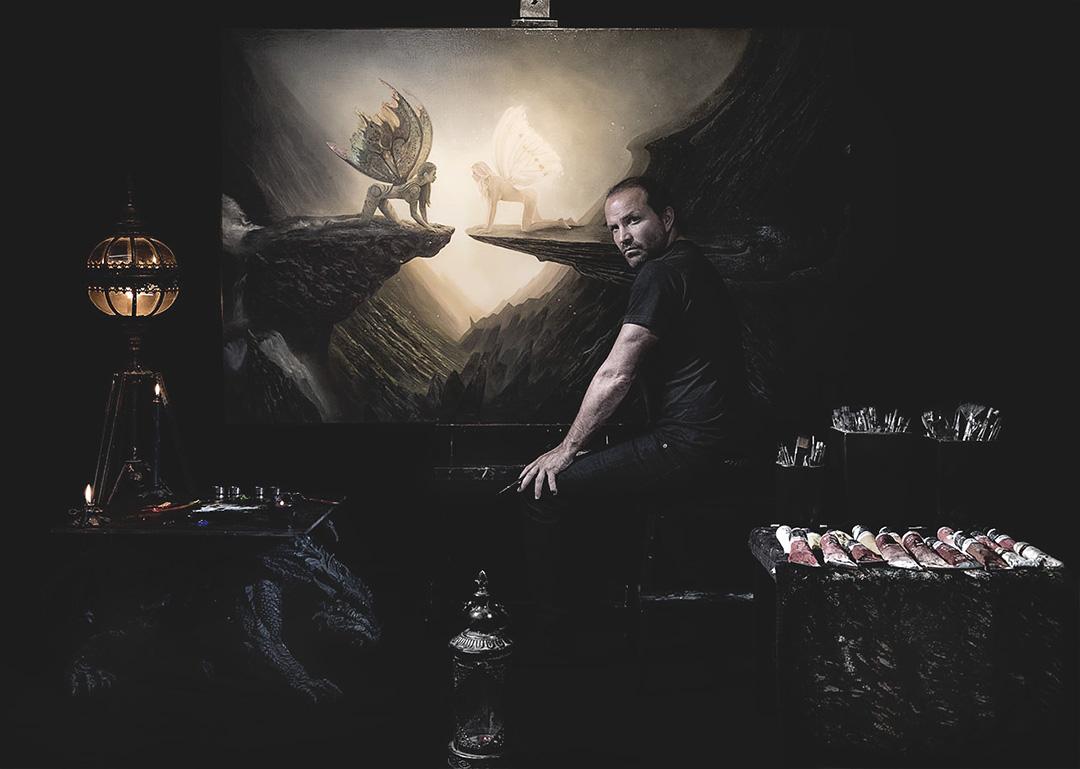 Photo of Garip Jensen at the studio easel in painting studio