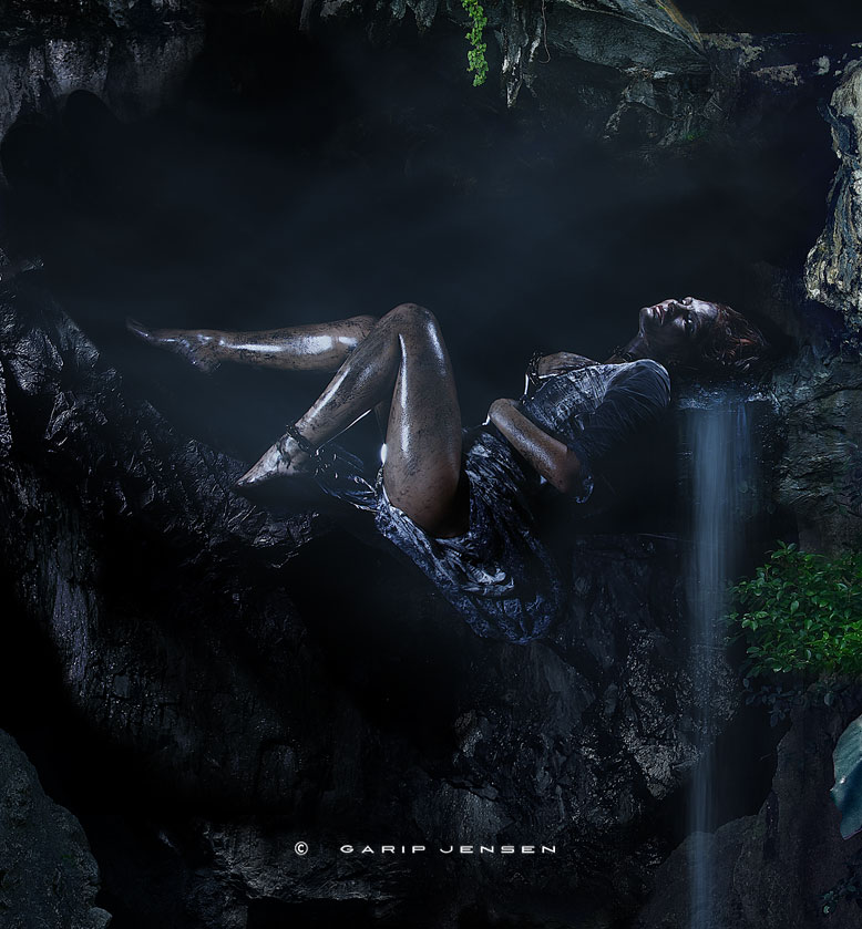 """Zooming in on the artwork """"Chapter four in the cave"""". Dirty female Swedish model is resting in an exotic cave."""