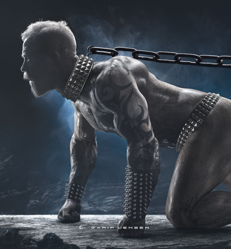 """A cropped version of the digital artwork """"survival of the fitest"""". A naked muscular tattooed man imprisoned in a chain around his neck."""